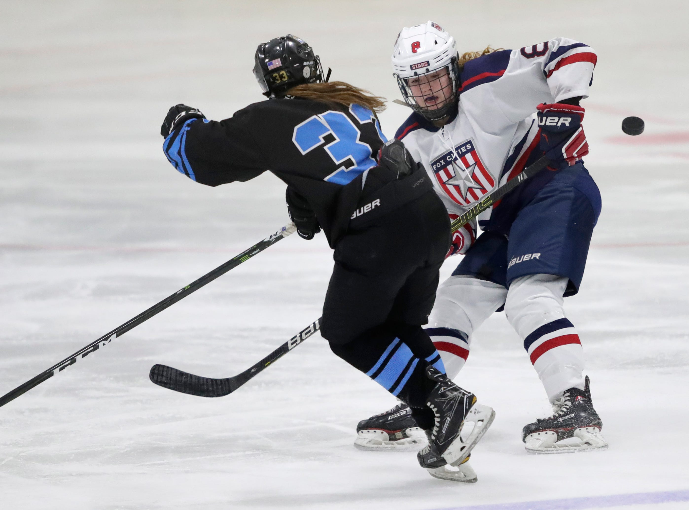 Fox Cities Stars' Victoria Nelson (8) goes up against Wisconsin Valley Union's Emily Nolan (33) during their girls hockey game Tuesday, December 18, 2018, at Tri-County Ice Arena in Fox Crossing, Wis. Dan Powers/USA TODAY NETWORK-Wisconsin