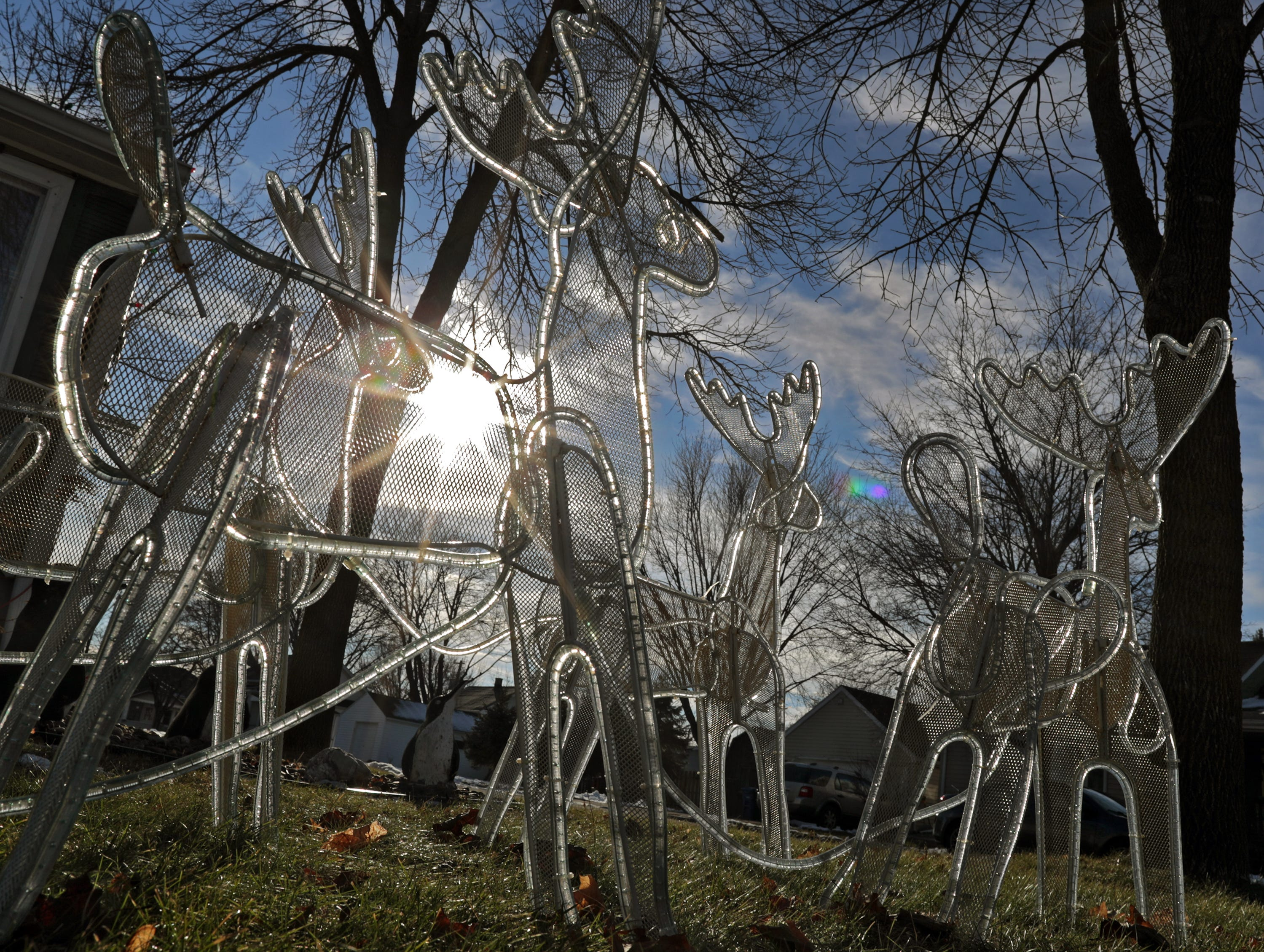 Hard sun shines through Christmas decrations on Lincoln Ave. on Tuesday, December 18, 2018, in Little Chute, Wis.Wm. Glasheen/USA TODAY NETWORK-Wisconsin.