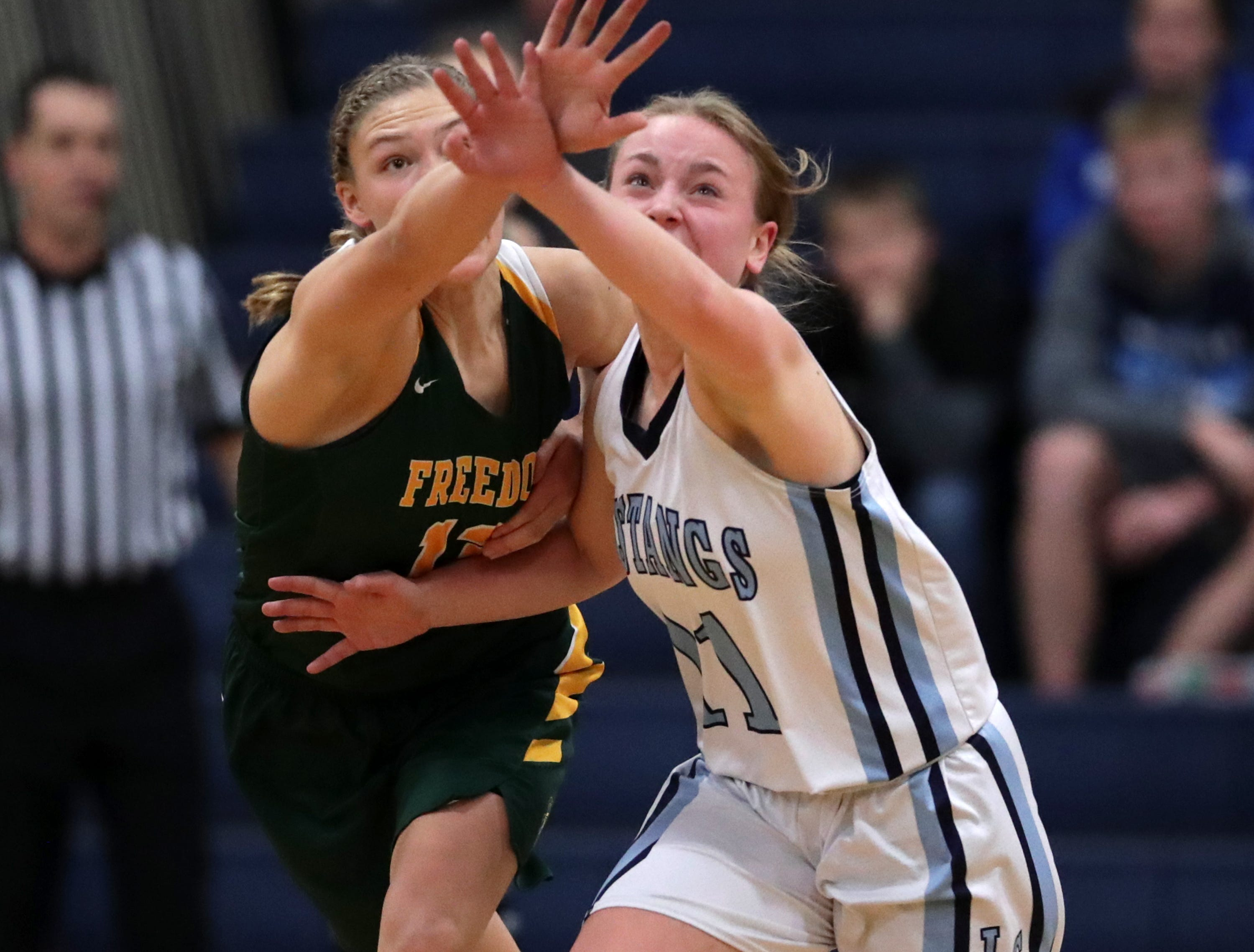 Little Chute High School's #11 Morgan Trzebiatowski  against Freedom High School's #14 Karissa Wurster during their North Eastern Conference girls basketball game on Friday, December 21, 2018, in Little Chute, Wis. Freedom beat Little Chute 56 to 42.Wm. Glasheen/USA TODAY NETWORK-Wisconsin.