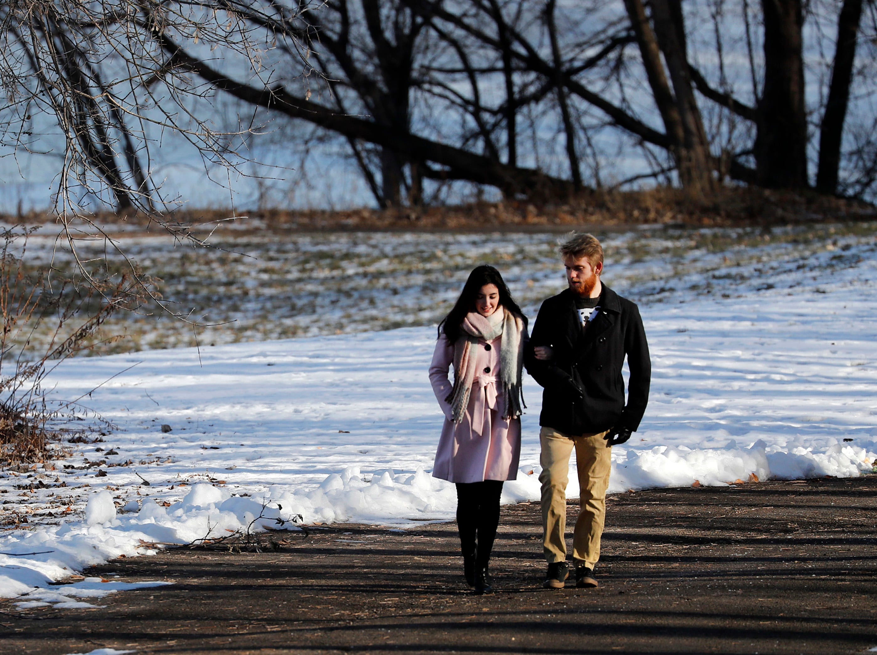 Rebecca Koopman, of Appleton, walks along a trail in Telulah Park with her boyfriend Ethan Craig, of Erie, Pa., Tuesday, Dec. 18, 2018, Appleton, Wis.Danny Damiani/USA TODAY NETWORK-Wisconsin