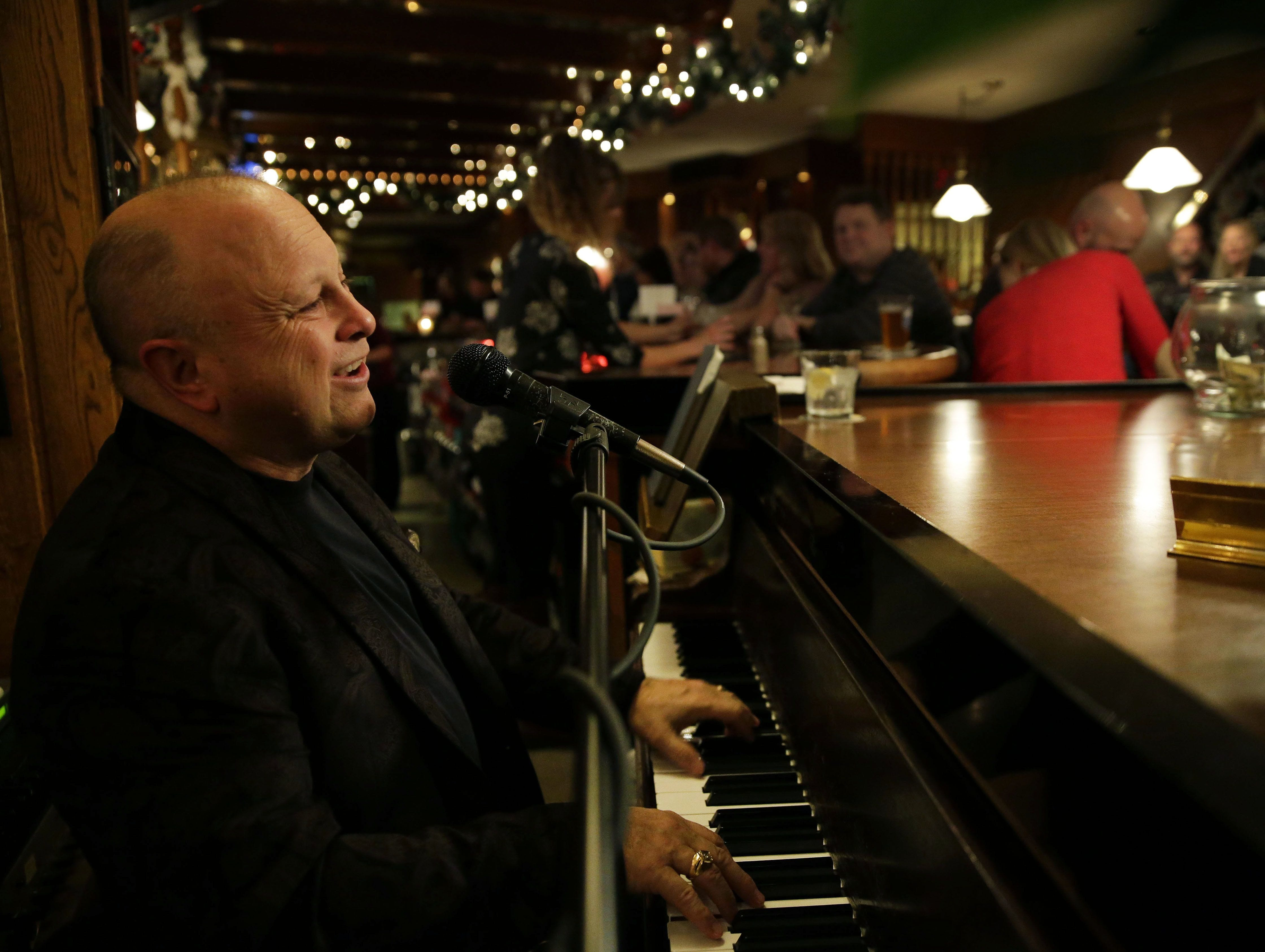 Bill Steinert of Oshkosh performs at George's Steak House in early December. Steinert has been playing at the Appleton restaurant for 35 years.