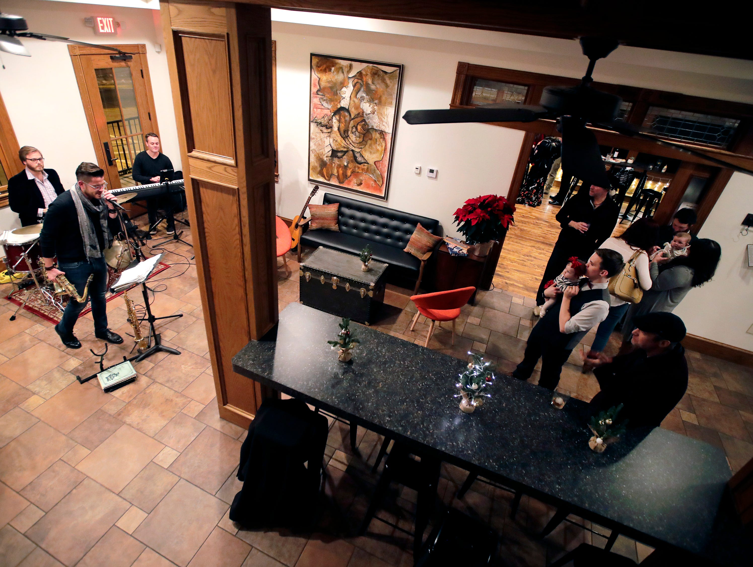 Jazz musicians Ross Catterton, Zach Harmon, Noah Harmon and Gordon Lewis perform for a private party during the soft opening for at 313 Dodge Thursday, Dec. 13, 2018, in Kaukauna, Wis.Danny Damiani/USA TODAY NETWORK-Wisconsin