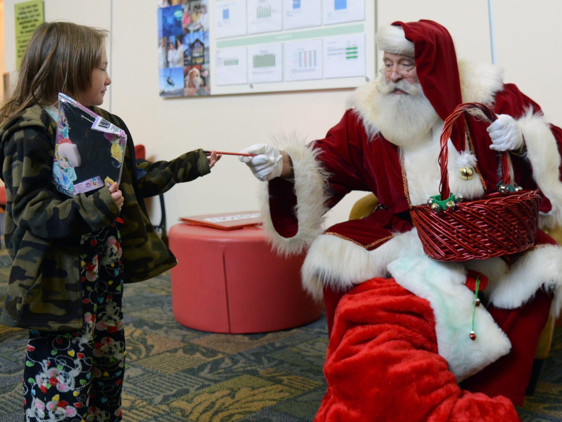 Shalimar Daniels visits Santa Claus Thursday morning at Mission Children's Hospital in November 2013.