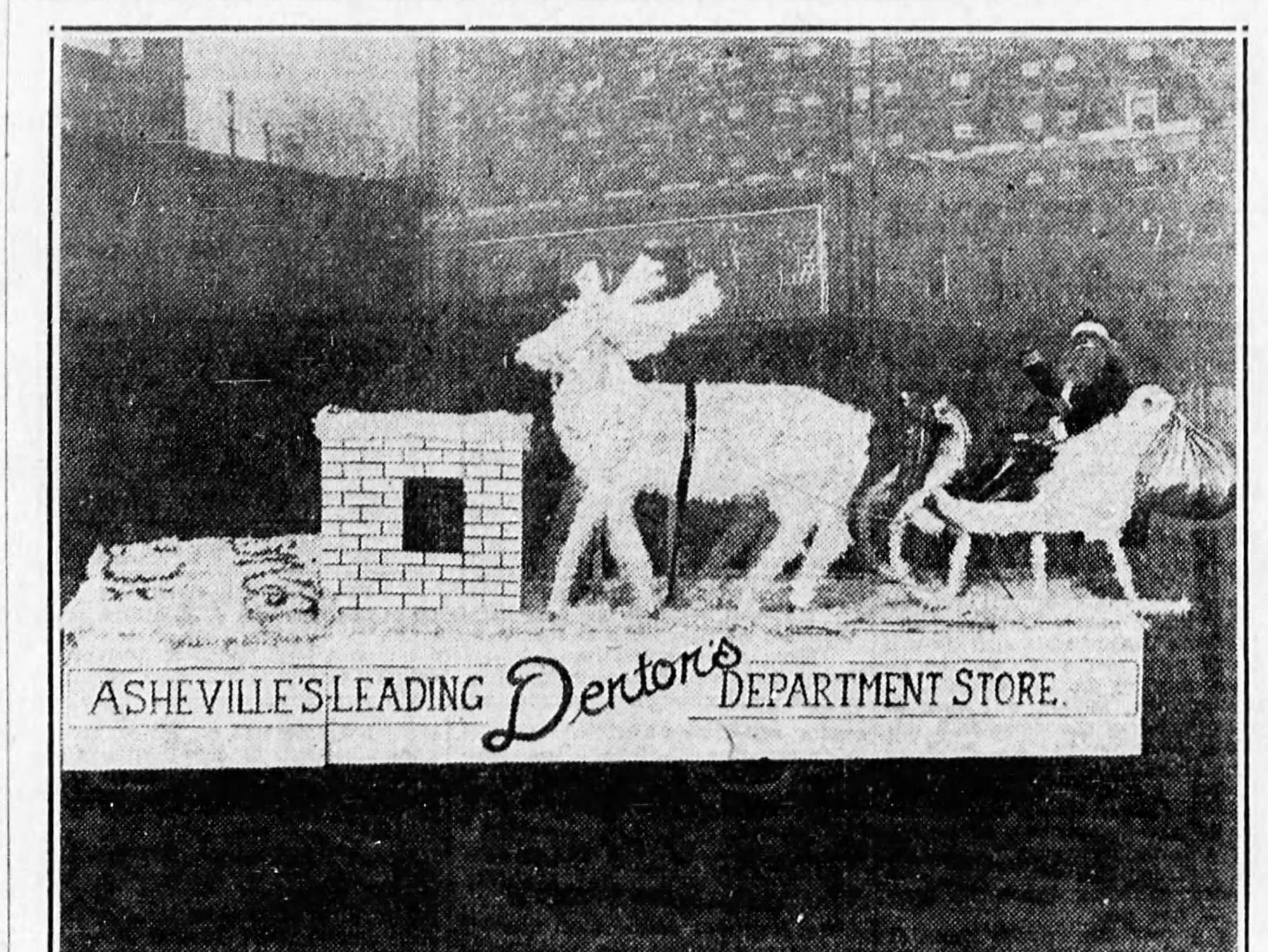 "Santa Claus visited Denton's Department Store on Haywood Street after a one-year absence from the store in December 1930. He is riding a sleigh with the slogan touting Denton's as ""Asheville's Leading Department Store."""