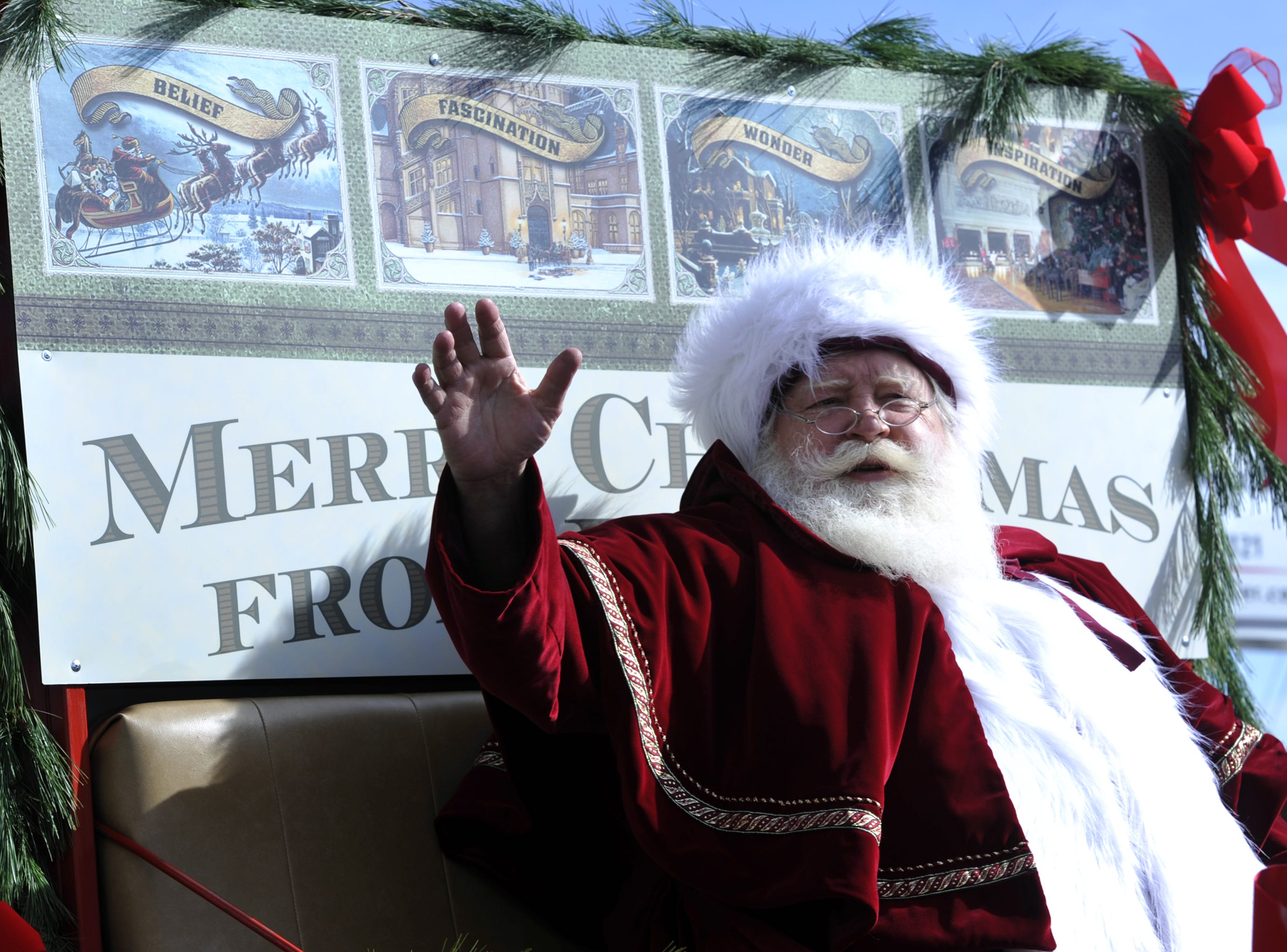 Santa Claus waves to the crowds during the 65th annual Asheville Holiday Parade in November 2011.  Around 90 groups participated in the parade.