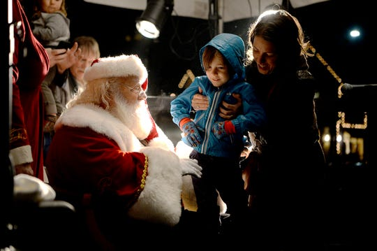 Obie Pass, 5, meets Santa Claus during the 30th annual Biltmore Village Dickens Festival in early December 2018.