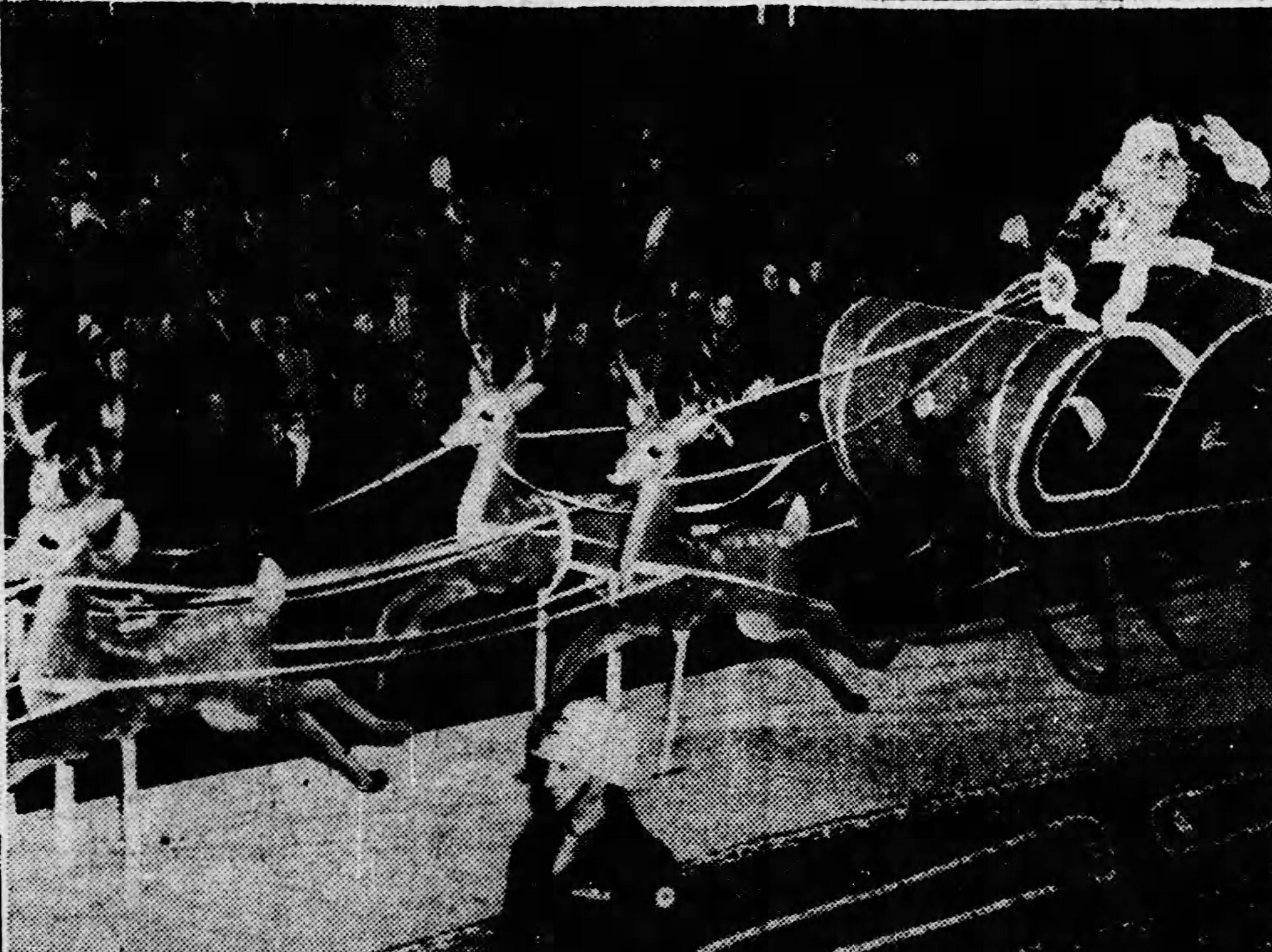 "Santa Claus and his reindeer move ""swiftly"" down a parade route in 1952 in Hendersonville."