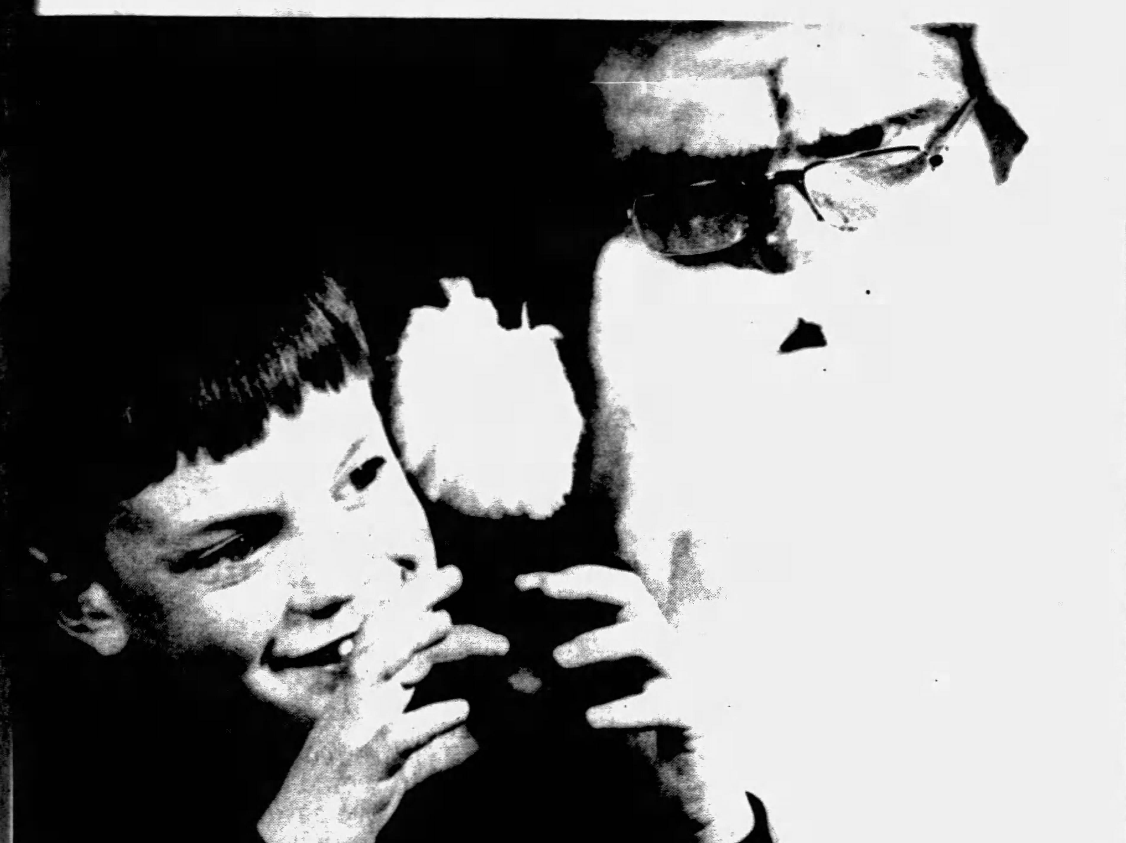 Arden resident Wilson Kieffer, 4, tells Santa Claus what he wants for Christmas during a December 1990 event in Asheville.