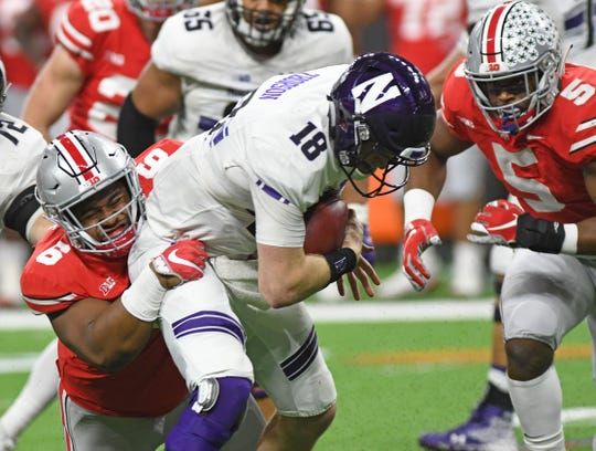 The Ohio State defense ranks just 67th nationally, but the Washington coaching staff knows it's stocked with elite athletes like Taron Vincent (6), who sacked Northwestern quarterback Clayton Thorson in the Big Ten championship game.