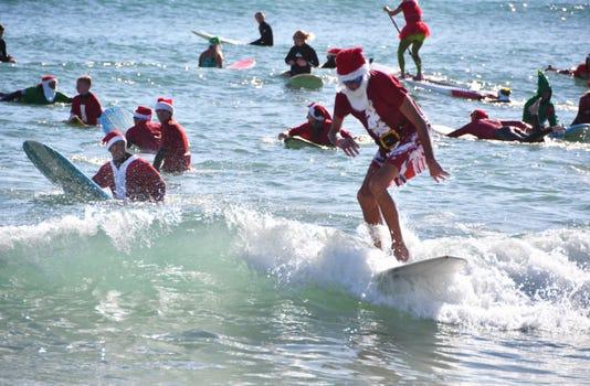 Surfing Santas Of Cocoa Beach