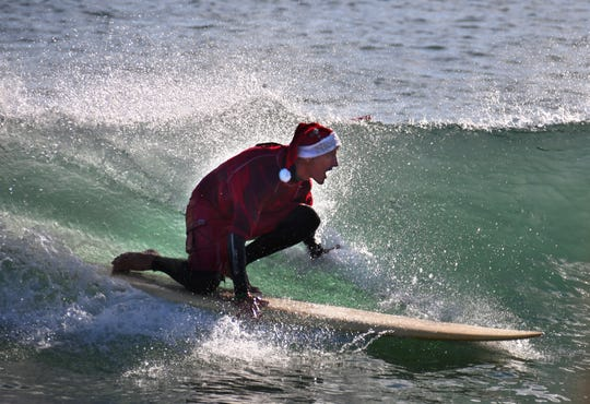 Thousands showed up in downtown Cocoa Beach for the annual Christmas Eve Surfing Santas event with hundreds of surfing Santas taking to the waves. The event, started by George Trosset,  raises money for the Florida Surf Museum and Grind for Life. The weather was perfect Florida weather with temperatures in the high 60's, unfortunately there were very small waves for the event.