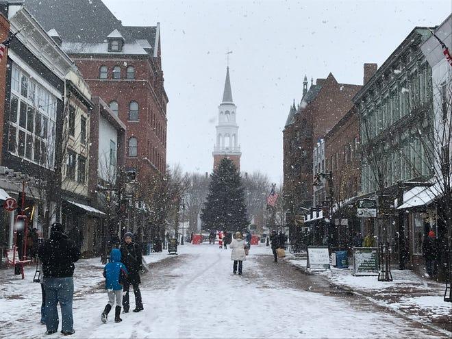 Snow fulfills Christmas dreams as shopping continues on Church Street in Burlington on Dec. 24, 2018.