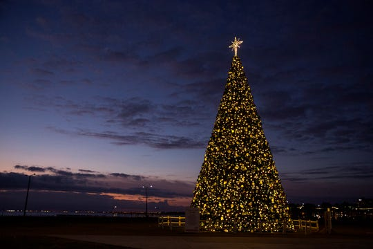 The H-E-B Christmas Tree at the Water's Edge Park glows bright as the sun rises on Christmas Eve on December 24, 2018.