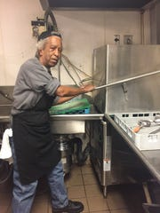 Dishwasher Bill Nash offers a look at Cathedral Kitchen's new dishwasher, donated with money raised from four local breweries.