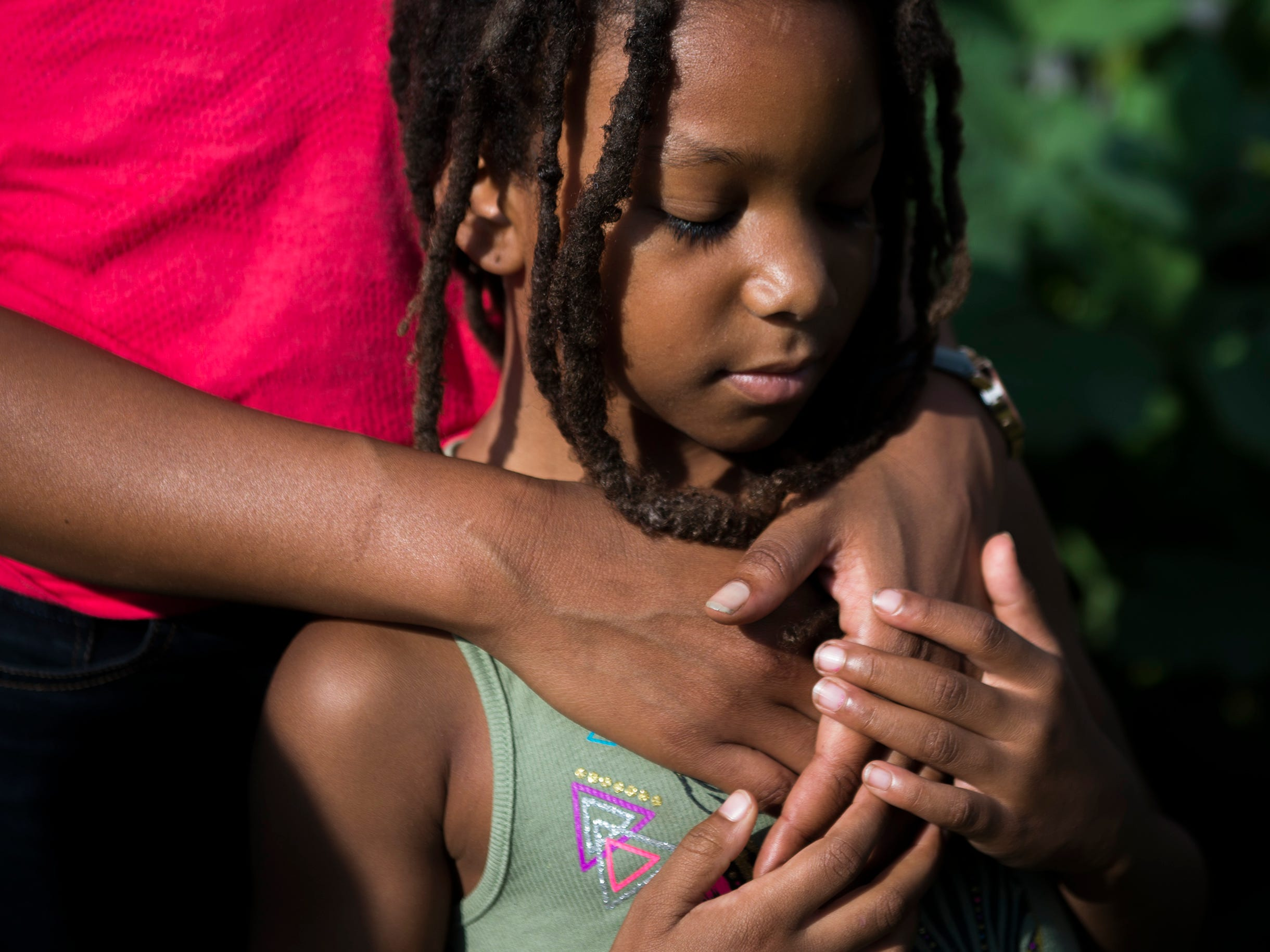 Dr. Cynthia Hall embraces her daughter Araminta, 7, on their farm Thursday, Aug. 23, 2018 at Free Haven Farms in Lawnside, N.J. Developed by abolitionists in the 1840s, the town was an Underground Railroad hub and remains a tight-knit, middle-class African-American community. ÒWe made that our philosophy,Ó she says. ÒBringing it full circle, and this location being a free haven for folks in terms of reeducating ourselves about health, nutrition and lifestyle.Ó