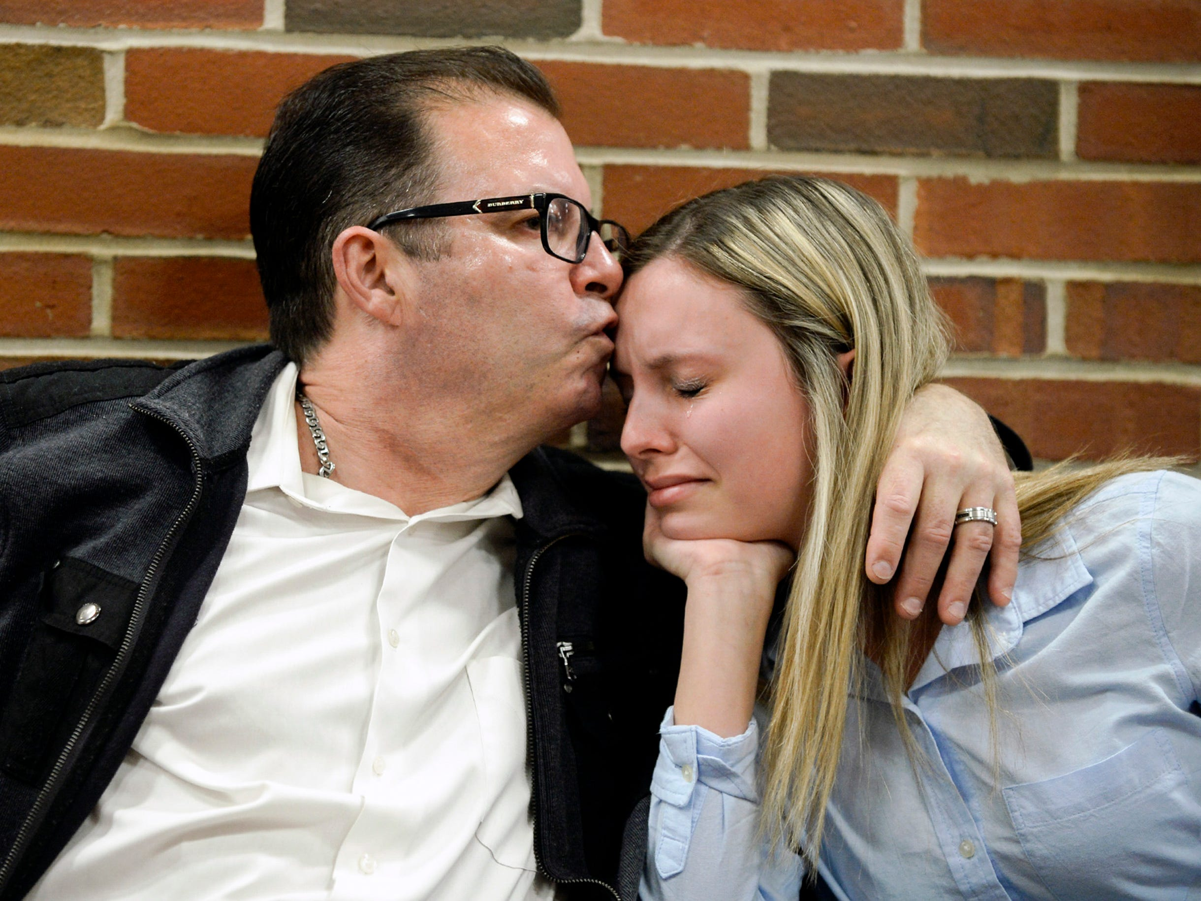 Steve McDonald kisses his daughter Devon McDonald, 18, of Marlton, while discussing the loss of their daughter and sister, 15-year-old Madison McDonald, following a detention hearing for Austin F. Cooper, 21, of Willingboro Wednesday, April 18, 2018 at Burlington County Superior Court in Mount Holly, N.J. Cooper, who is charged with strict liability for an opioid-induced death of Madison McDonald, will remain detained until trial.