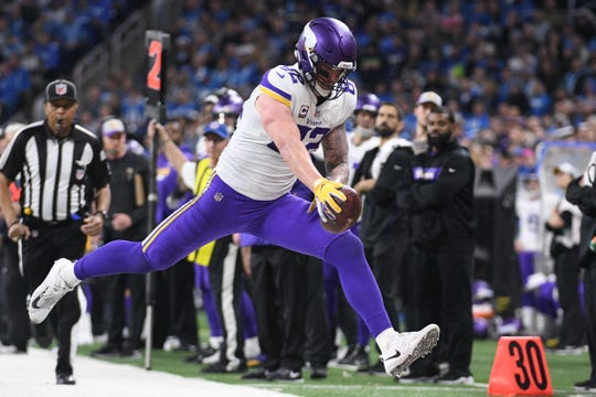 Minnesota Vikings tight end Kyle Rudolph (82) reaches for a first down during the second half against the Detroit Lions at Ford Field.