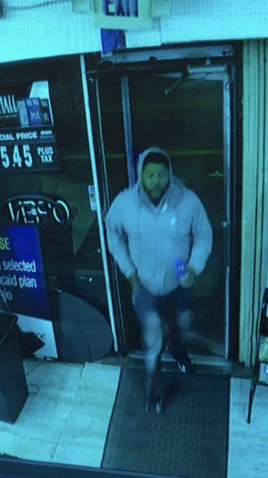 Police released three video stills of a suspect wanted in connection with the shooting of two people Saturday, Dec. 22 in the 1800 block of Vine Street.