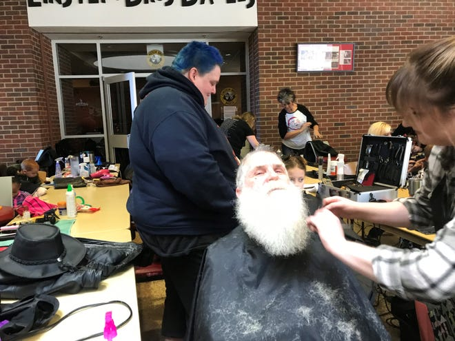 About 2,000 people showed up for Warm Souls where they enjoyed free food, gifts, complimentary haircuts and even a beard trim.