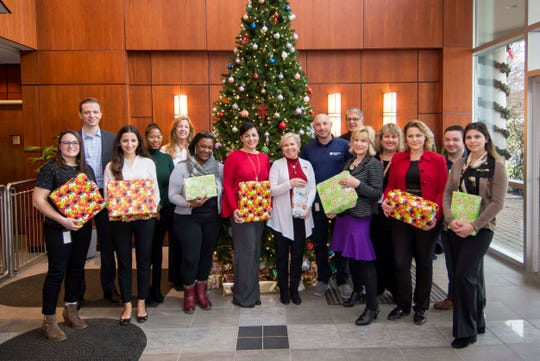 Some of the Team Columbia volunteers who helped collect, wrap and distribute the holiday gifts to the participating organizations.