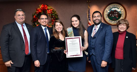 Union County Freeholder Chairman Sergio Granados, Vice Chairman Bette Jane Kowalski and Freeholder Alexander Mirabella present a resolution to Audrey Davis of Fanwood Girl Scout Heart of New Jersey Troop 40274.They were joined by Manuel Ramirez and Nicole DeAugustine of the Union County the Office for Persons with Disabilities & Special Needs.