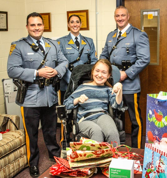 Troopers' kindness brightens holiday for Del Val student PHOTO CAPTION