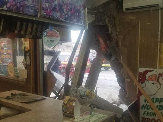The view from within the B&B Grocery on southeast 6th Street shows the damages the structure sustained when the SUV crashed into it.