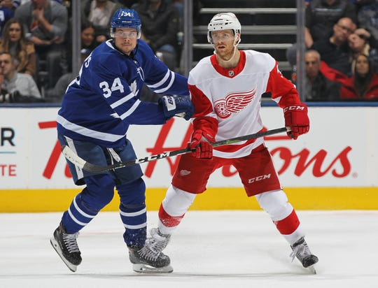 Red Wings defenseman Nick Jensen skates against the Maple Leafs' Auston Matthews on Sunday, Dec. 23, 2018, in Toronto.