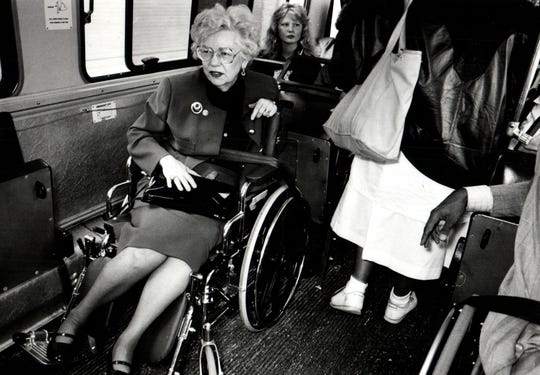 In this photo from the Detroit Free Press archive, Detroit City Council President Maryann Mahaffey rides a bus to the City County Building to experience life as a person in a wheelchair.
