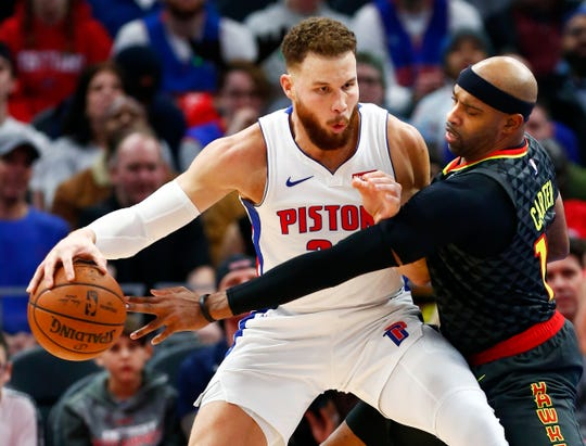 Hawks forward Vince Carter, right, tries to steal the ball from Pistons forward Blake Griffin, left, during the second half of the Pistons' 98-95 loss on Sunday, Dec. 23, 2018, at Little Caesars Arena.