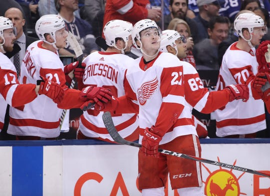 Red Wings center Michael Rasmussen is congratulated by teammates after scoring a goal in the first period on Sunday, Dec. 23, 2018, in Toronto.