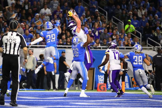 Vikings tight end Kyle Rudolph brings in a Hail Mary for a TD to end the second quarter against the Lions at Ford Field on Dec. 23, 2018.