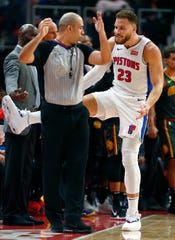 Pistons forward Blake Griffin argues with NBA official Brandon Adair, left, after being whistled for a foul during the first half of the Pistons' 98-95 loss on Sunday, Dec. 23, 2018, at Little Caesars Arena.