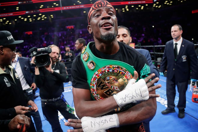 Detroit native Tony Harrison celebrates after defeating Jermell Charlo in a WBC super welterweight championship boxing match Saturday night.