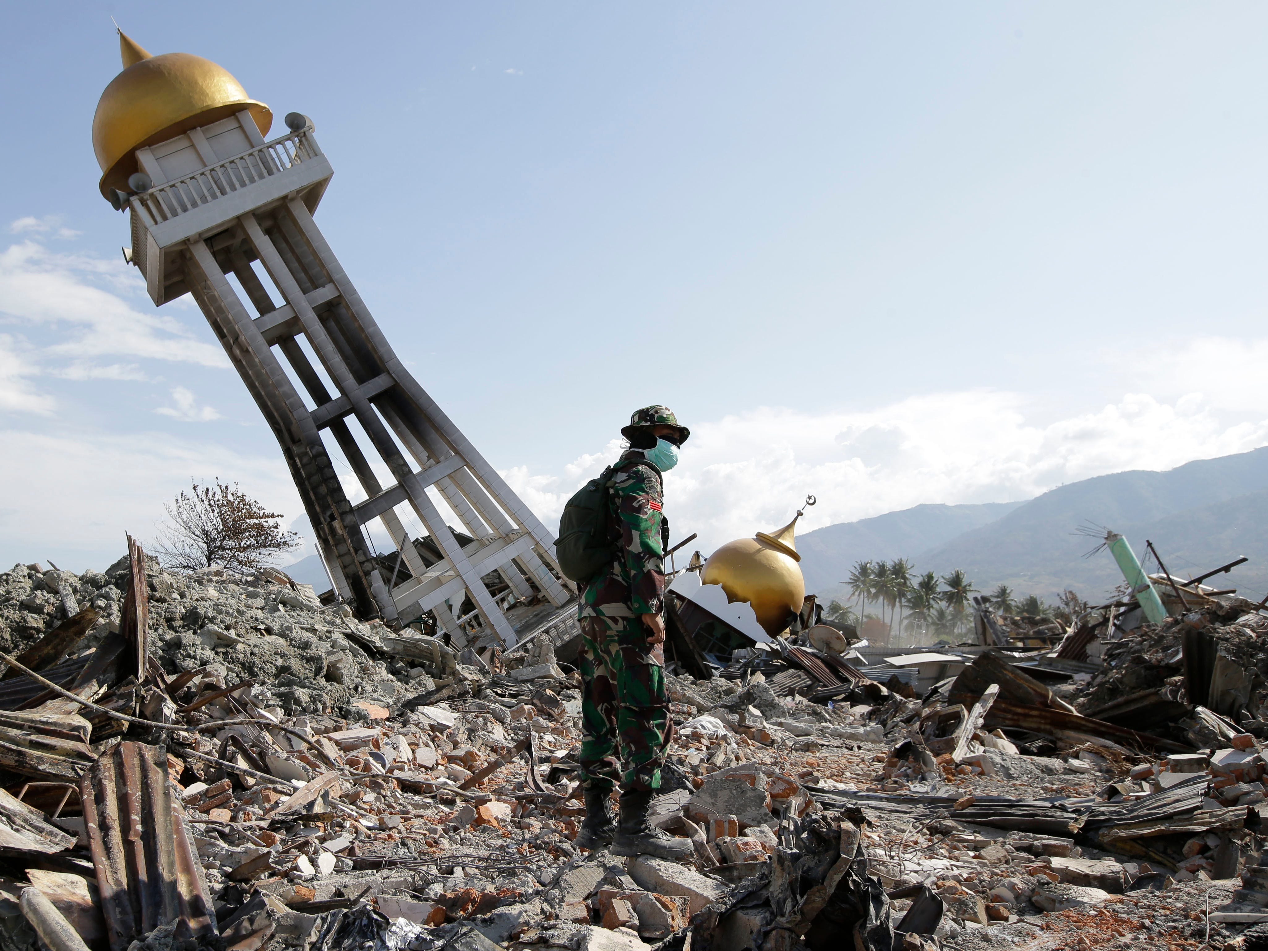 An Indonesian trooper stands beside a toppled mosque as recovery efforts continue at the earthquake-hit Balaroa neighborhood in Palu, Central Sulawesi, Indonesia, on Oct. 6, 2018.