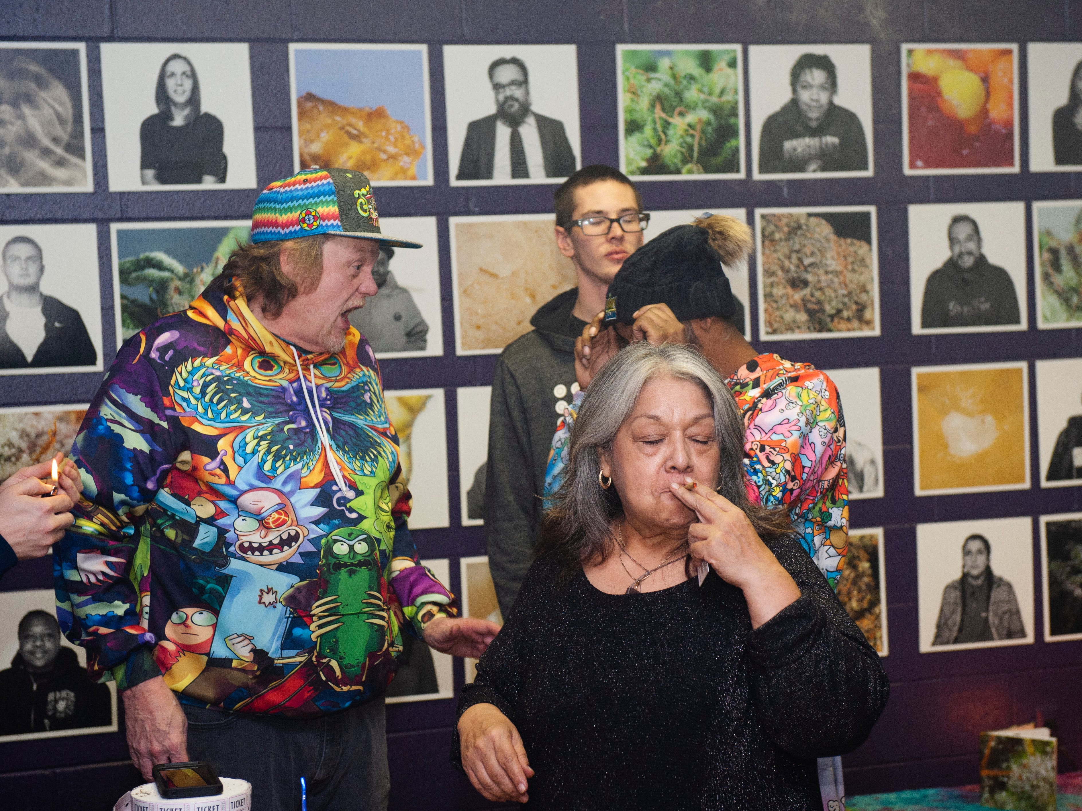 """Joanne Diaz, 65, of Flint takes a hit during """"The Art of Cannabis"""" event at the Cannabis Counsel in Detroit on Saturday, Dec. 22, 2018. Diaz said she's smoked marijuana since she was 15 years old."""