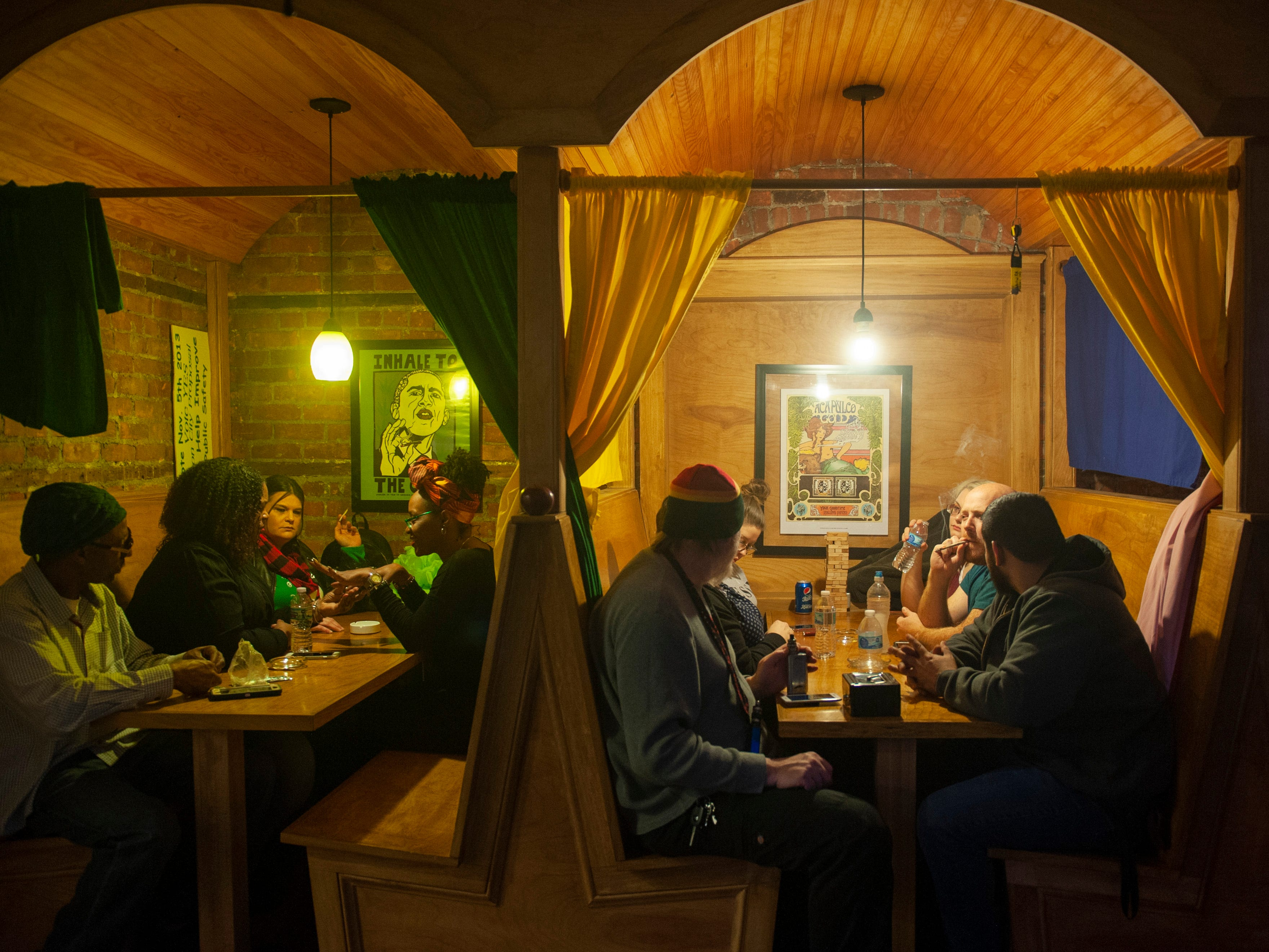 """Guests at """"The Art of Cannabis"""" event at the Cannabis Counsel in Detroit hang out in restaurant-style booths smoking marijuana and waiting for the festivities to begin on Saturday, Dec. 22, 2018."""