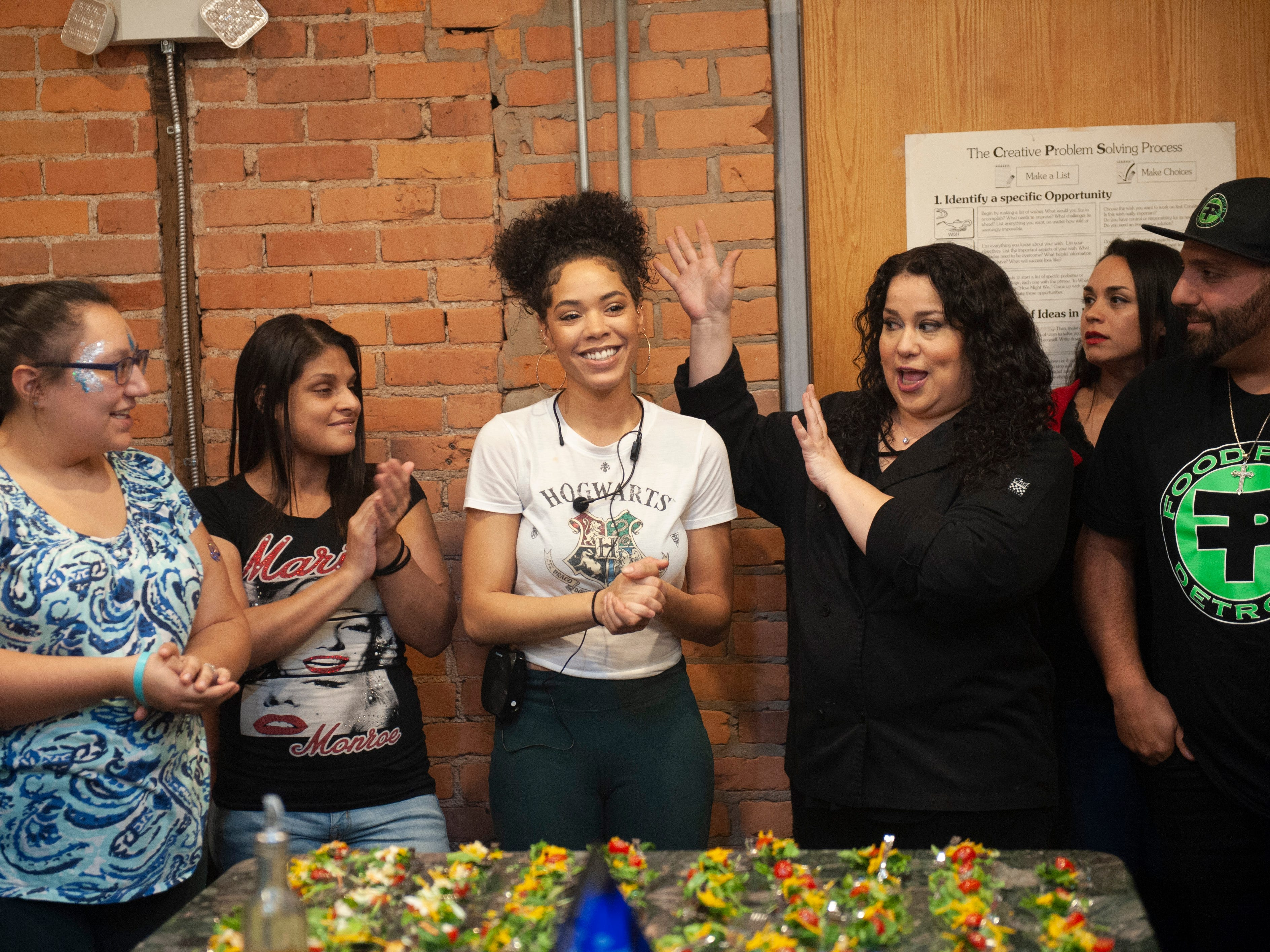 """Cannabis Concepts chef Gigi Diaz  introduces fellow chef Donya Jade, center, and other cannabis entrepreneurs offering demonstrations and free samples of their THC-infused goodies at """"The Art of Cannabis"""" art exhibition and tasting at the Cannabis Counsel in Detroit on Saturday, Dec. 22, 2018."""