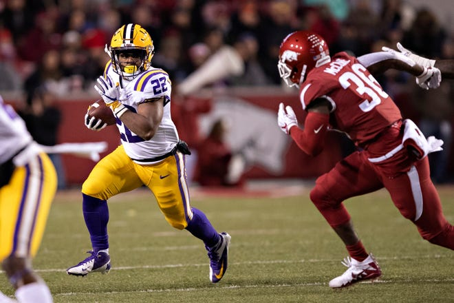 LSU's Clyde Edwards-Helaire (22) is believed to have been involved in a fatal shooting where he and teammate were targeted in a robbery.