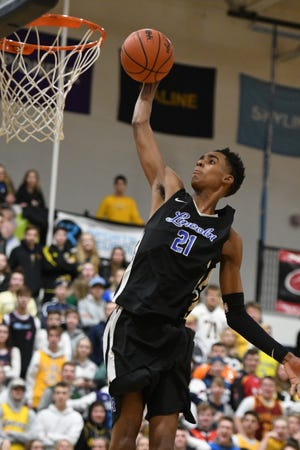 Ypsilanti Lincoln freshman Emoni Bates, pictured here in a game against Saline earlier this season, scored 36 points and had 19 rebounds in his team's SEC White-title clinching 73-65 victory over Jackson on Monday.