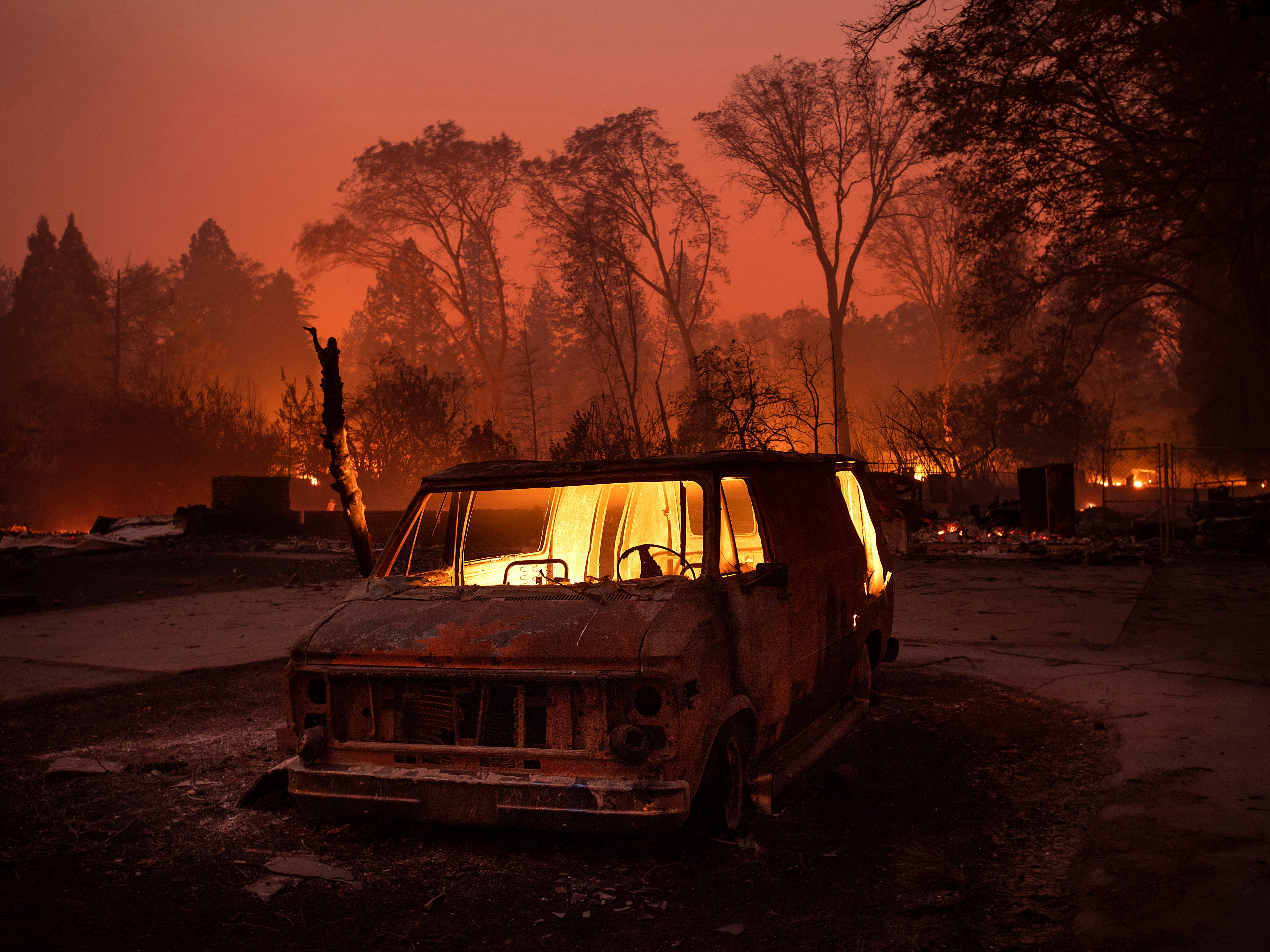 Flames burn inside a van as the Camp Fire tears through Paradise, Calif., on Nov. 8, 2018. Tens of thousands of people fled a fast-moving wildfire, some clutching babies and pets as they abandoned vehicles and struck out on foot ahead of the flames that forced the evacuation of an entire town and destroyed hundreds of structures.
