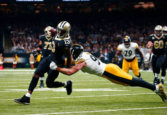 Saints wide receiver Michael Thomas tries to elude linebacker J.J. Watt in the first half of Sunday's win over the Steelers.