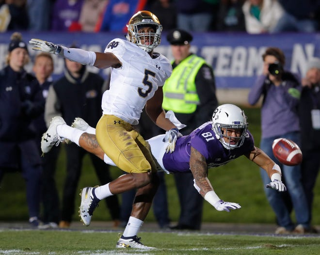 Northwestern's Ramaud Chiaokhiao-Bowman, right, dives for the ball but cannot make the catch as Notre Dame's Troy Pride Jr. defends during a game earlier this season.