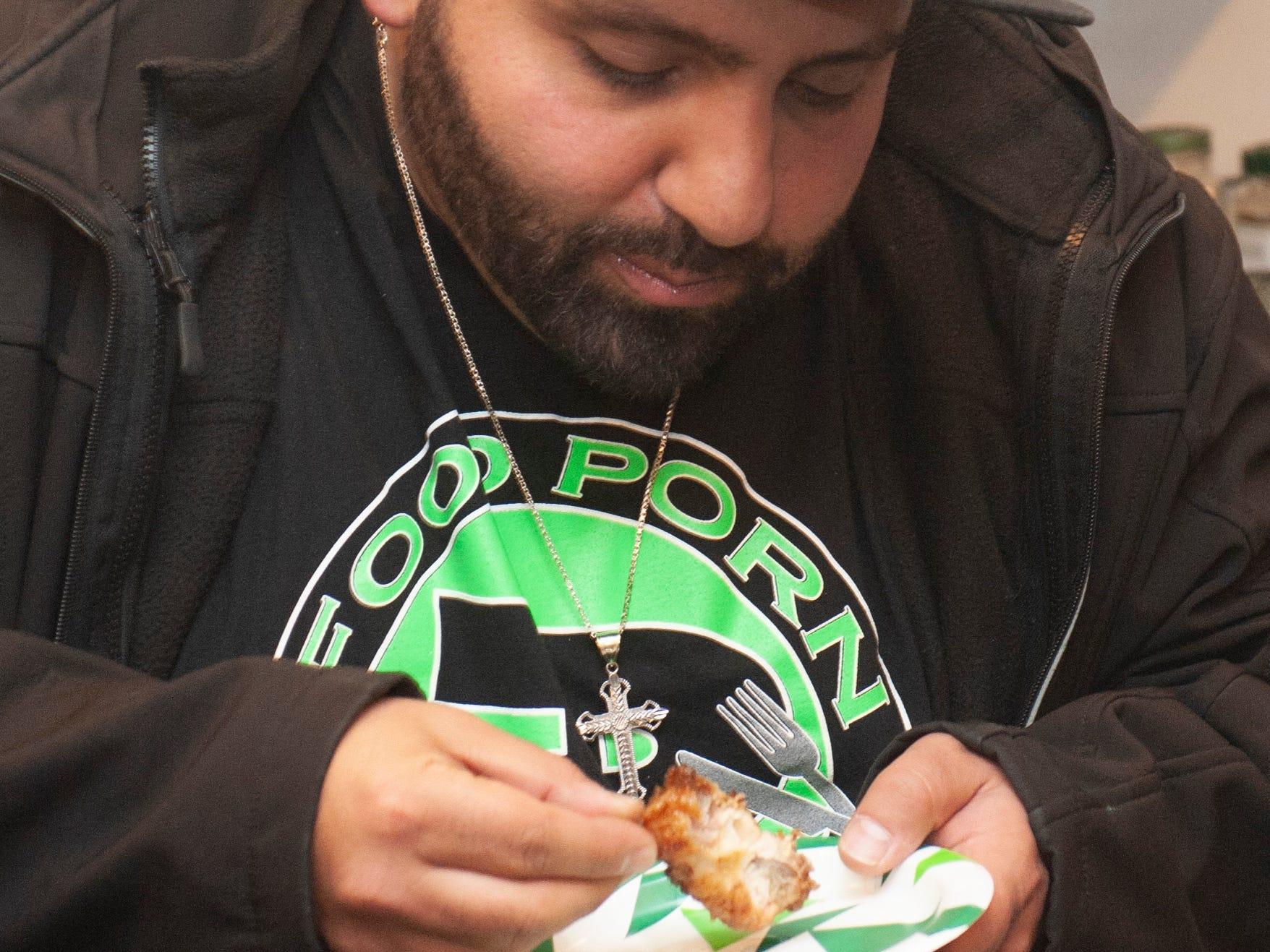"Foodie blogger Gus Muffareh of ""Food Porn Detroit"" samples chef Gigi Diaz' cannabis-infused Kush Cola chicken wings."