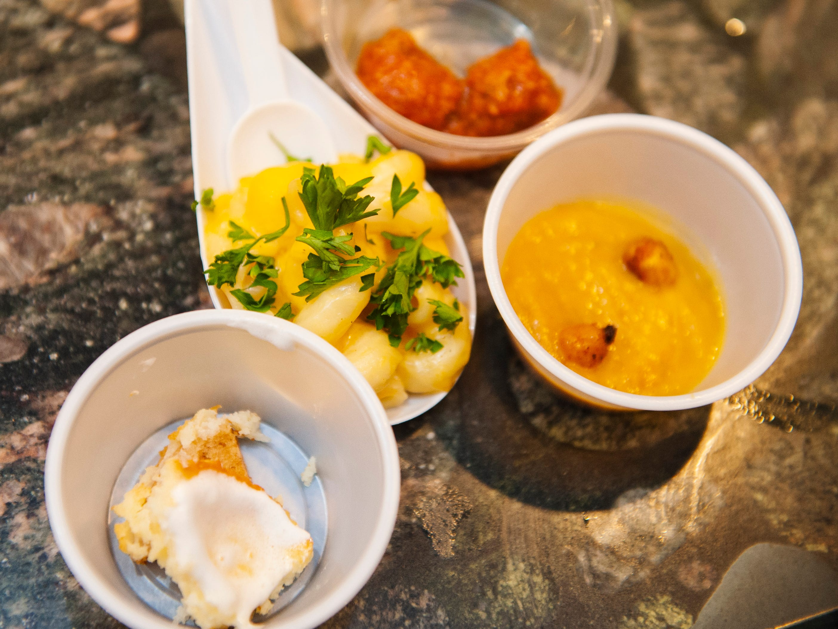 Free cannabis-infused food samples include, from left, cheesecake, macaroni and cheese, meatballs and butternut squash soup with roasted chipotle chick peas.