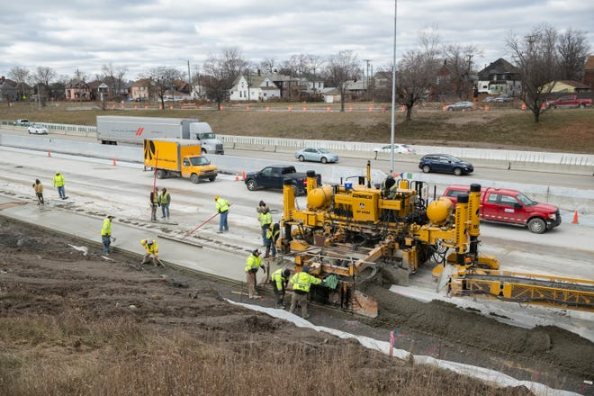 Construction workers pour concrete on I-75 near Livernois in Detroit, December 17, 2018.  Heaters are used to keep fresh concrete from freezing and cracking in cold temperatures.