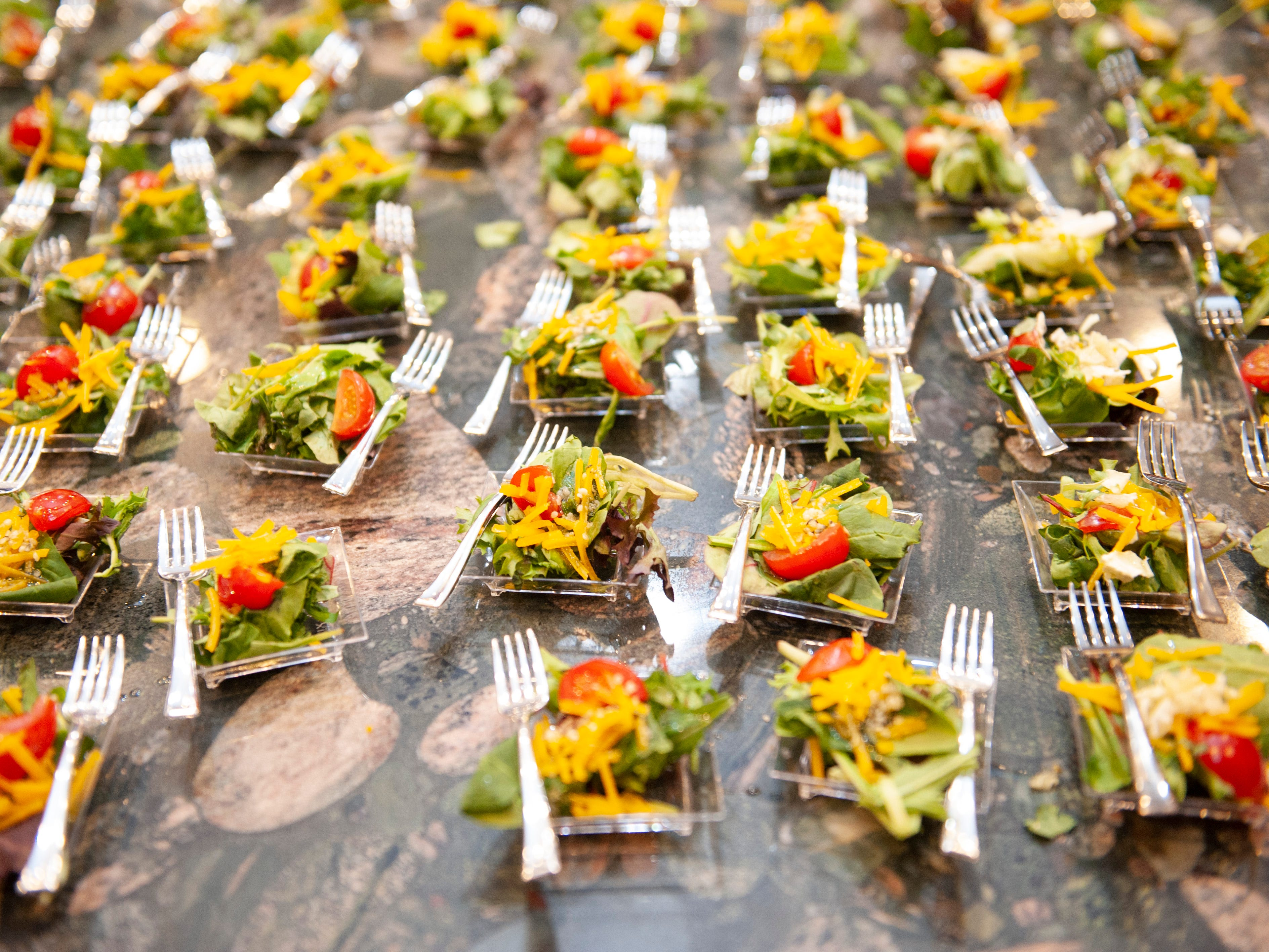 Cannabis-infused salad appetizers by Chef Gigi Diaz are displayed as free samples for guests to enjoy.