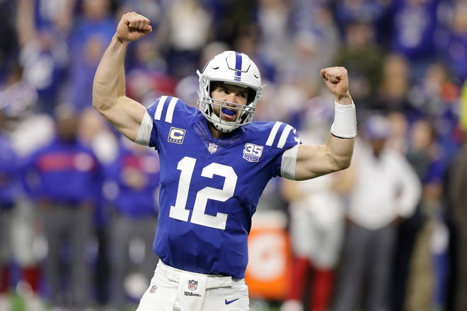 Indianapolis Colts quarterback Andrew Luck celebrates a game-winning touchdown during the second half against the New York Giants on Sunday.