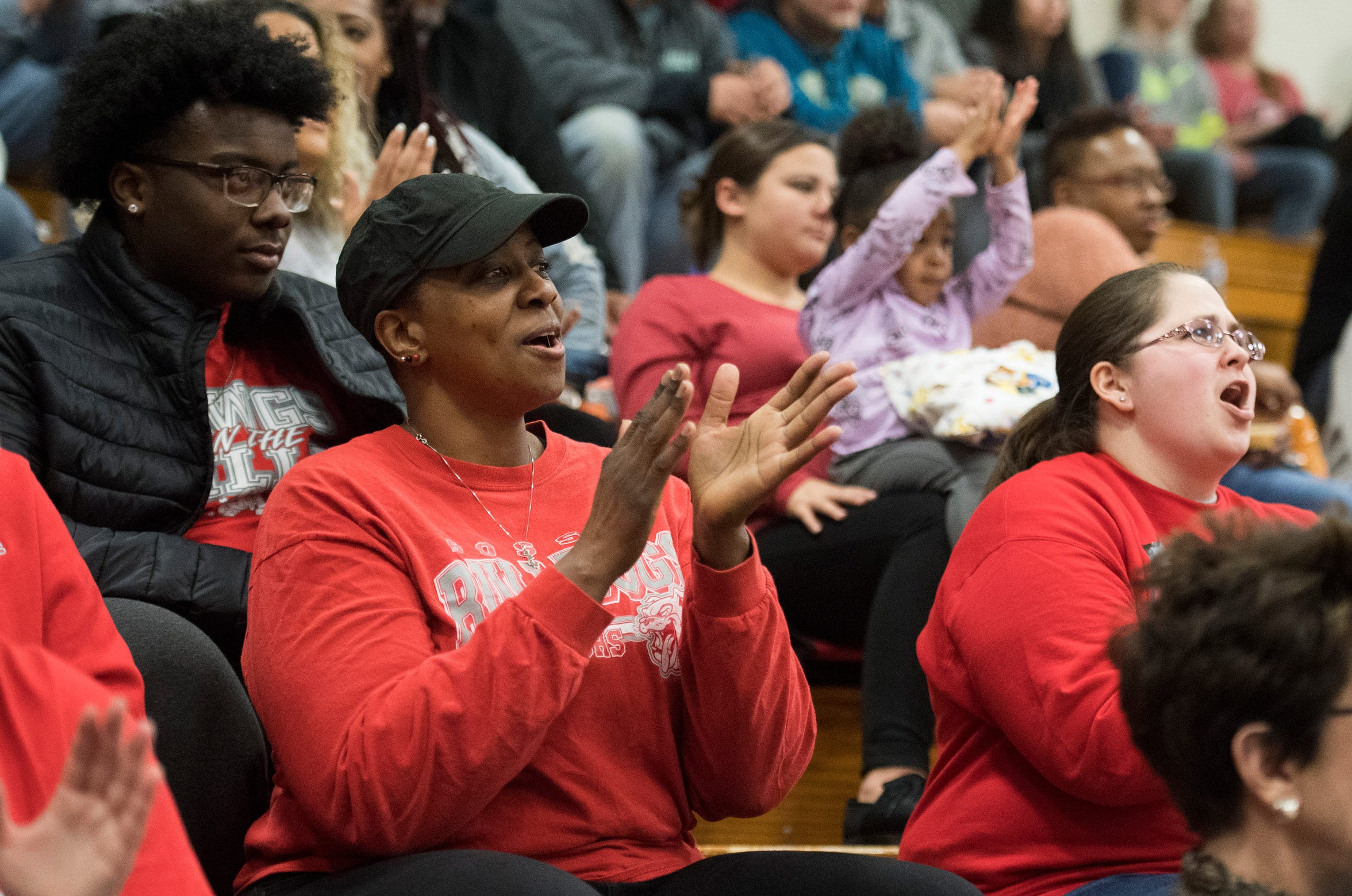 Teresa Higgins, mother of Bosse High School junior Kiyron Powell cheers on the Bulldogs during the Memorial vs Bosse game Tuesday, Dec. 11, 2018.