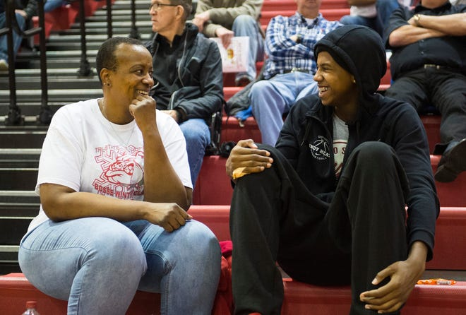 Bosse High School junior Kiyron Powell sits with his mother, Teresa Higgins during the seventh-annual Bosse Winter Classic Saturday, Dec. 15, 2018.